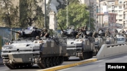 Lebanese army convoy secures portions of Beirut after a night of violent clashes, October 22, 2012.