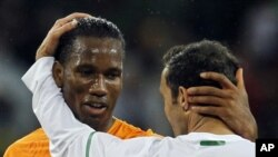 Ivory Coast's Didier Drogba, left, greets Portugal's Ricardo Carvalho at the end of the World Cup group G soccer match between Ivory Coast and Portugal at Nelson Mandela Bay Stadium in Port Elizabeth, South Africa, Tuesday, June 15, 2010. The game ended