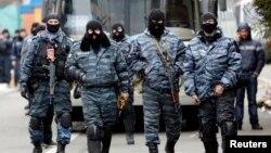 Lực lượng cảnh sát chống bạo động Berkut bị tố cáo đã nhắm bắn và đánh đập người biểu tình chống chính phủ ở Kyiv.