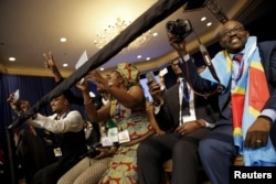 FILE: Attendees cheer as U.S. President Barack Obama (not pictured) arrives onstage at the Young African Leaders Initiative (YALI) Mandela Washington Fellowship Presidential Summit in Washington, August 3, 2015.