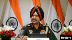 Indian army's director general of military operations Lt General Ranbir Singh speaks to the media in New Delhi. India says it launched a strike against militants inside Pakistan.