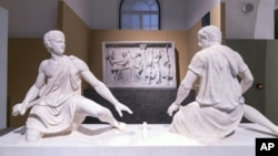 In this undated photo made available Monday, Oct. 12, 2020, ancient Greek and Roman marble statues are seen prior to going on display in the newly refurbished Villa Caffarelli. (Fondazione Torlonia via AP)