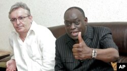 The lawyers of the deposed leader of Chad Hissene Habre, French Francois Serres (L), Senegalese El Hadj Diouf (R) hold a press conference. Senegal has suspended its plan to send Chad's former dictator Hissene Habre back to his own country, July 10, 2011
