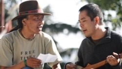 The filmmaker, Ngawang Choephel, right, and a friend, prepare a traditional song for 'Tibet in Song'