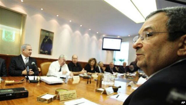 "Israeli Prime Minister Benjamin Netanyahu, left, and Israeli Defense Minister Ehud Barak, front right, at a cabinet meeting that approved a controversial bill requiring new citizens to pledge allegiance to a ""Jewish and democratic"" state. Jerusalem, 10 Oc"