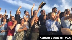 Supporters cheer as Democratic presidential candidate Bernie Sanders speaks outside R.F.K. Stadium, in southeast Washington, June 9, 2016.
