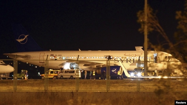 A Syrian passenger plane, which was forced to land, sits at Esenboga airport in Ankara October 10, 2012.