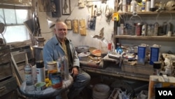 Clarke Bedford in his home studio, where he transforms junk into fantastical art.