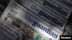 Copies of the Guardian newspaper are displayed at a newsstand in London, August 21 2013.