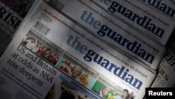 Copies of the Guardian newspaper are displayed at a news agent in London, Aug. 21 2013.