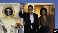 Барак и Мишель Обама прилетели в Чикаго на саммит НАТО