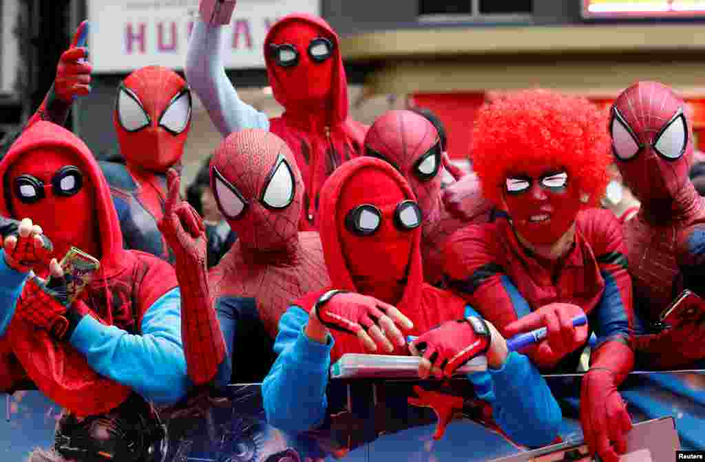 "Fans in Spider-Man costumes wait for the arrival of cast member Tom Holland and director Jon Watts during the Japan premiere of ""Spider-Man: Homecoming"" in Tokyo, Japan."