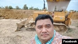 Sok Oudom, pictured at a construction site, is the owner of Rithysen radio station and a local citizen journalist in Kampong Chhnang province, Cambodia. (Courtesy of Facebook)