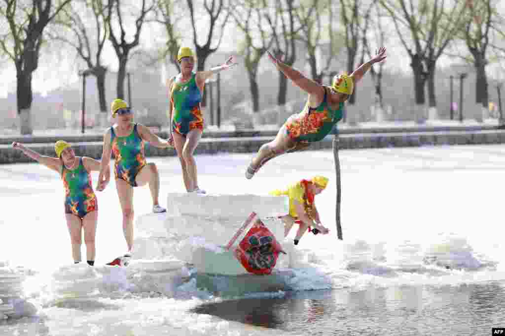 A woman dives into a partly frozen lake in Shenyang in China's northeastern Liaoning province.