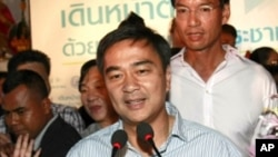 Thai Prime Minister and leader of Democrat Party Abhisit Vejjajiva gestures during a news conference at the party's headquarters Sunday, July 3, 2011 in Bangkok, Thailand