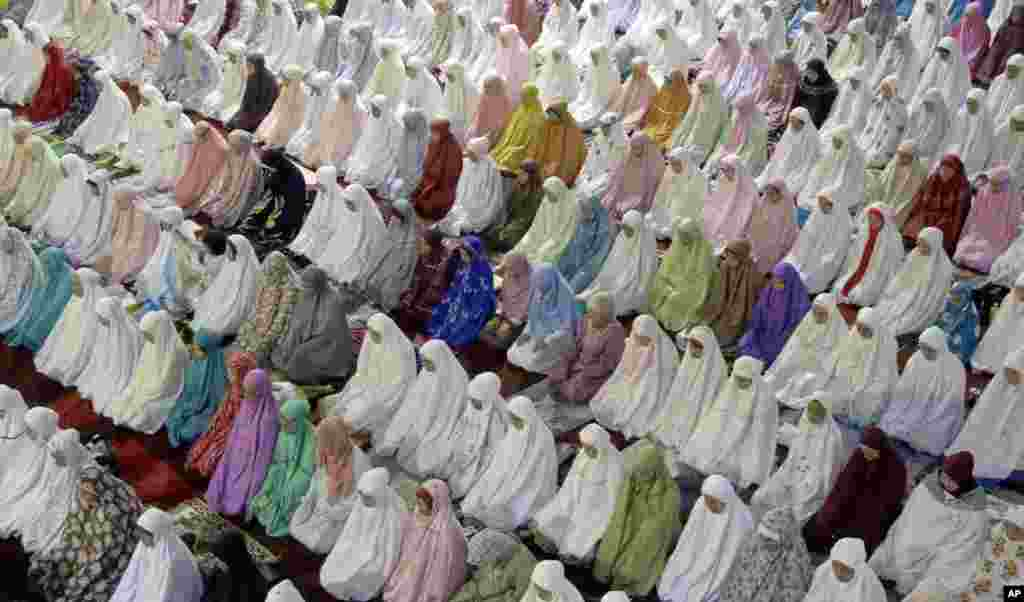 Muslim women perform an evening prayer called 'tarawih' marking the first eve of the holy fasting month of Ramadan, at Istiqlal Mosque in Jakarta, Indonesia.