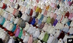 FILE - Muslim women perform an evening prayer in Jakarta, Indonesia, June 5, 2016. Only 29 percent of young people in a recent U.S. survey were able to pinpoint Indonesia as being a Muslim-majority country.