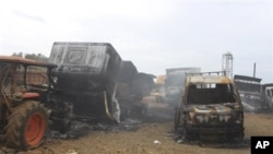 Trucks allegedly burned by communist rebels lie at the compound of Taganito Mining Corp, partly owned by a Japanese company, in Surigao del Norte province, southern Philippines on Tuesday Oct. 4, 2011. Philippine President Benigno Aquino III has ordered s