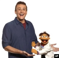 """(L-R)Jason Segel and Walter in """"The Muppets"""""""