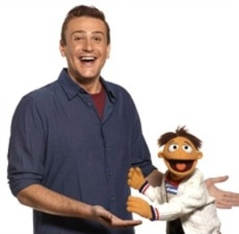 "(L-R)Jason Segel and Walter in ""The Muppets"""