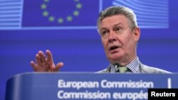 FILE - European Trade Commissioner Karel De Gucht speaks during a news conference at the EU Commission headquarters in Brussels.