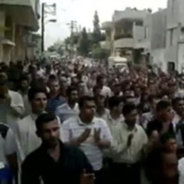 An image from footage uploaded on YouTube shows Syrian anti-government protesters flooding the streets of the central city of Hama, July 8, 2011, to demand the fall of the regime President Bashar al-Assad