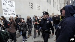 'Occupy Wall Street' protesters march to a Verizon office to support employees there who are picketing in New York, Tuesday, Oct. 4, 2011.