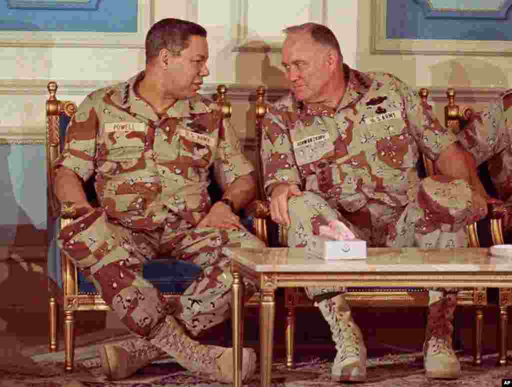 Then Chairman of the Joint Chiefs of Staff Geneneral Colin Powell, left, confers with General Norman Schwarzkopf at an airbase in central Saudi Arabia on February 8, 1991.