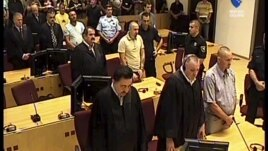 A TV image provided by the Bosnian war crimes court showing former Bosnian Serb soldiers Franc Kos, first row right, Stanko Kojic second row center, Vlastimir Golijan third row center, and Zoran Goronja, fourth row right, during the pronouncement of the v