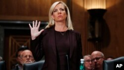 Kirstjen Nielsen is sworn in at a hearing on her nomination to be Department of Homeland Security Secretary, by the Senate Homeland Security and Governmental Affairs committee, Nov. 8, 2017, in Washington.