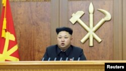 FILE - North Korean leader Kim Jong Un delivers a New Year's address.