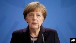 德國總理默克爾3月24日資料照片。