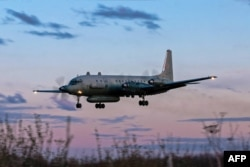 FILE - A photo taken on July 23, 2006 shows an Russian IL-20M (Ilyushin 20m) plane landing at an unknown location. Russia blamed Israel on Sept. 18, 2018 for the loss of a military IL-20M jet to Syrian fire, which killed all 15 servicemen on board.