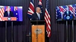 PM Australia Scott Morrison (tengah) dalam konferensi pers bersama secara virtual dengan PM Inggris Boris Johnson dan Presiden AS Joe Biden Kamis, 16 September 2021.