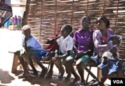 Children wait for their mothers at the Antenatal Clinic in South Sudan. (VOA - H. McNeish)