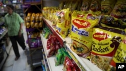 "Packaged food with ""Maggi"" sign on it are displayed at a grocery store in Bangalore, India, June 5, 2015."