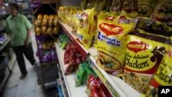 "FILE - Packaged food with ""Maggi"" sign on it are displayed at a grocery store in Bangalore, India, June 5, 2015."