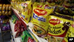 """FILE - Packaged food with """"Maggi"""" sign on it are displayed at a grocery store in Bangalore, India, June 5, 2015."""