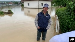 Poplave u Doboju, 14. maj 2019. (AP Photo/Eldar Emric)