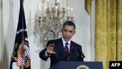 Tổng thống Mỹ Barack Obama trả lời ký giả trong 1 cuộc họp báo tại Tòa Bạch Ốc, 29/6/2011