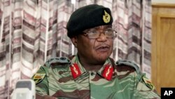 Zimbabwe's Army Commander, Constantino Chiwenga addresses a press conference in Harare, Nov. 13, 2017. The army commander Monday criticized the instability in the country's ruling party caused by President Robert Mugabe who last week fired a vice presiden