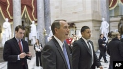 House Speaker John Boehner of Ohio walks through Statuary Hall on Capitol Hill in Washington, Jan 6, 2011
