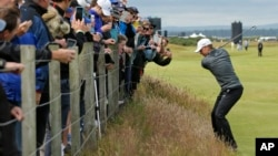 United States' Jordan Spieth plays from the rough on hole 16 during a practice round at the British Open Golf Championship at the Old Course, St. Andrews, Scotland, July 15, 2015.
