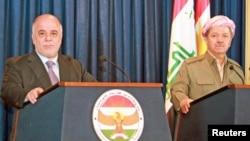 PM Irak Haider al-Abadi (kiri) dan Presiden Irak Kurdistan Massoud Barzani dalam konferensi pers di Irbil, Senin (6/4).