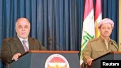 伊拉克总理阿巴迪和伊拉克库尔德斯坦总统马苏德·巴尔扎尼在记者会上(2015年4月6日)