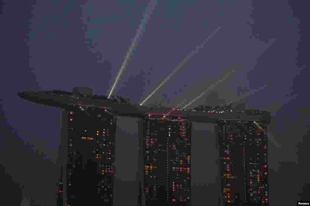 A laser light show plays from the top of the Marina Bay Sands integrated resort during haze in Singapore.