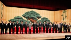 APEC leaders take part in a group photo at the APEC summit in Yokohama, Japan, 13 Nov 2010