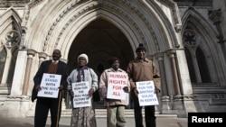 Wambugu Nyingi, Jane Muthoni, Paul Nzili and Ndiku Mutua (L-R) stand outside the High Court in London April 7, 2011.