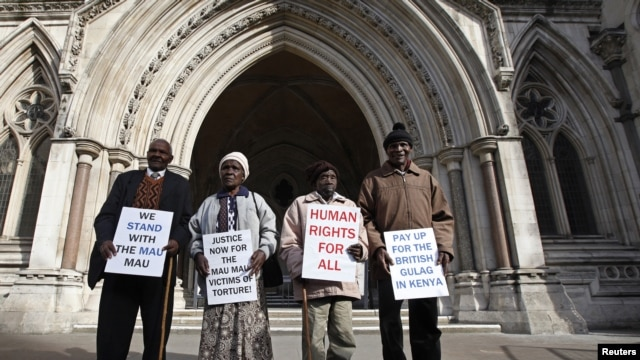 Wambugu Nyingi, Jane Muthoni, Paul Nzili and Ndiku Mutua (L-R) stand outside the High Court in London April 7, 2011.