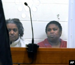 FILE - In this Feb. 1, 2018 file photo, sisters Rachel Hilaire and Peggy LaBossiere sit in Brockton District Court in Bridgewater, Mass.